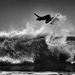 Another flying surfer from the US Open in Huntington Beach. ISO 200, 365mm, f5.6, 1/1250. Processed in Adobe Camera Raw to increase exposure and blacks. Imagenomic Noiseware noise reduction, and black and white conversion using Nik Silver Efex.